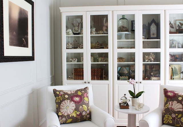 ikea  fancy white liatorp cabinets  glass doors ektorp white slipcovered chairs