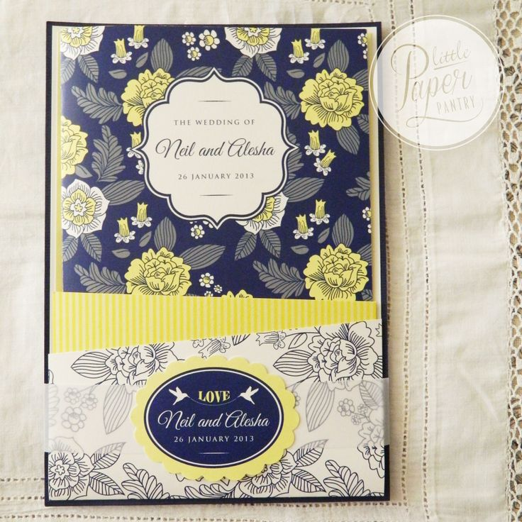 Navy, white and lemon floral and pinstripe invite with translucent belly band