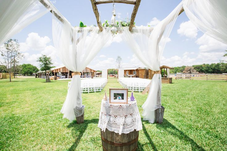 Plant City Outdoor Rustic Wedding Ceremony Altar with Pink and Purple Flowers and Barrel | Plant City Wedding Venue Wishing Well Barn