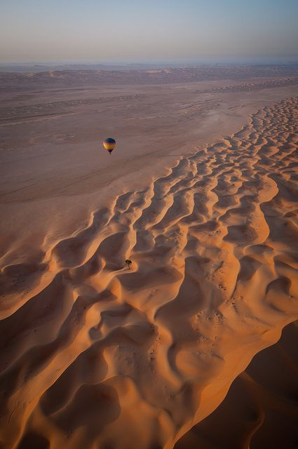 Floating over sand dunes, Rub' al Khali Desert, United Arab Emirates (by joeborg).