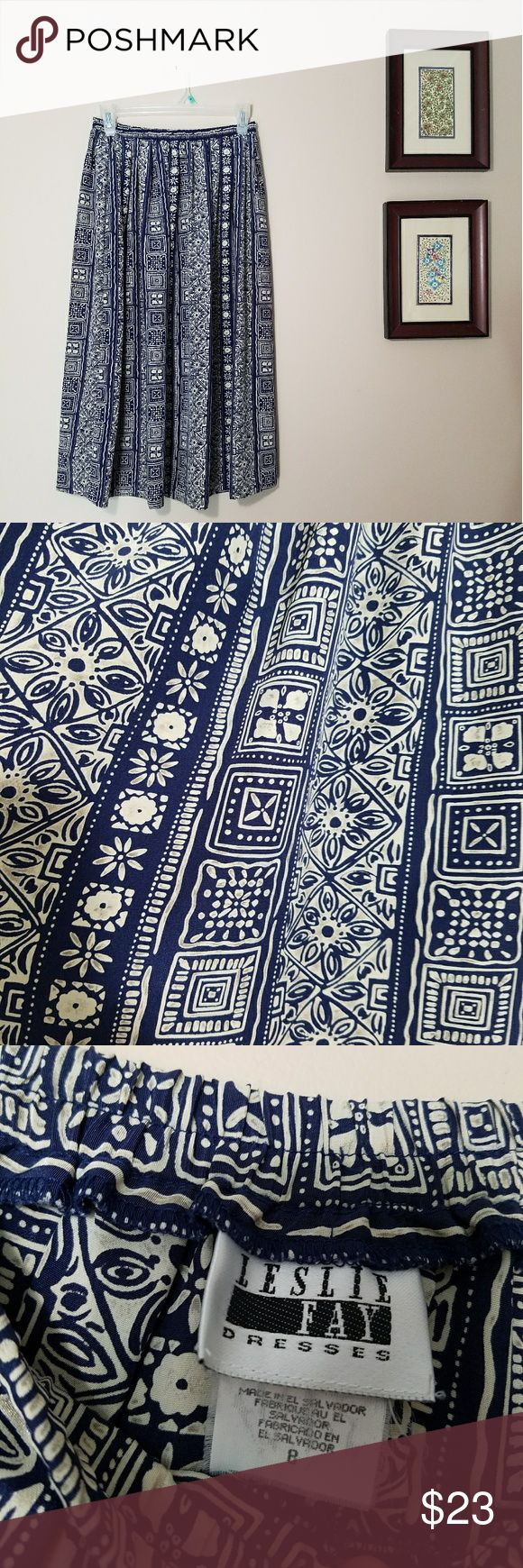 High Waisted Midi Tribal Print Skirt Leslie Fay Adorable high waisted skirt in size 8. Great flowy material and cute tribal print! Leslie Fay Skirts Midi