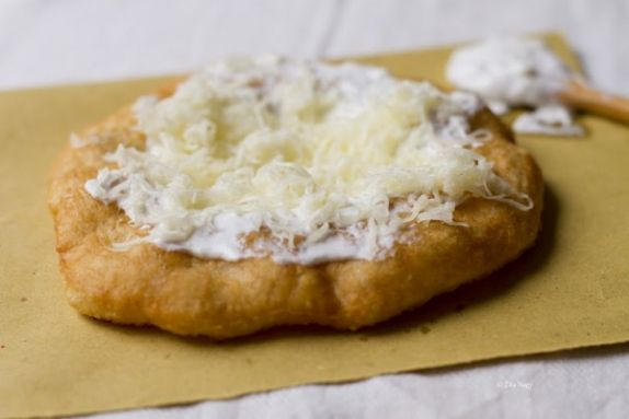 Langos. Hungarian fried dough bread, basically smothered in sour cream and cheese. WIN.