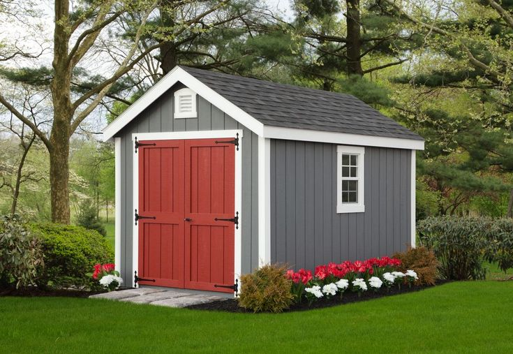Shed With T 111 Siding In Grey With Dark Blue Trim