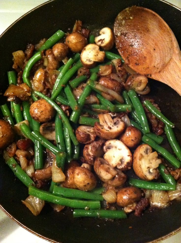 Best Green Bean & Mushroom Side Dish! Cut beans to 2inches-snap off ends. Boil beans 3 min, drain and blanch in bowl of cold water to stop the cooking. In pan Sauté 1/2 onion, sliced mushrooms, bacon bits for 5 min. Add 3 cloves minced garlic-cook 1 more min. Add 1t parsley, 1/8 t nutmeg, 1/8 t cracked black pepper, salt to taste. Add drained beans from cold water bowl and saute 2-4 min to melt flavors together. Serve immediately. Hearty enough to serve with just meat. So good!!!