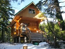 """Troubridge log cabin on the Sunshine Coast Trail in BC (nearing completion). Not sure if I""""ll see this on my hiking press trip in May...but would be cool!"""