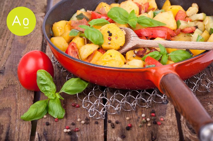Fresh roasted potatoes fried in a pan with vegetables.