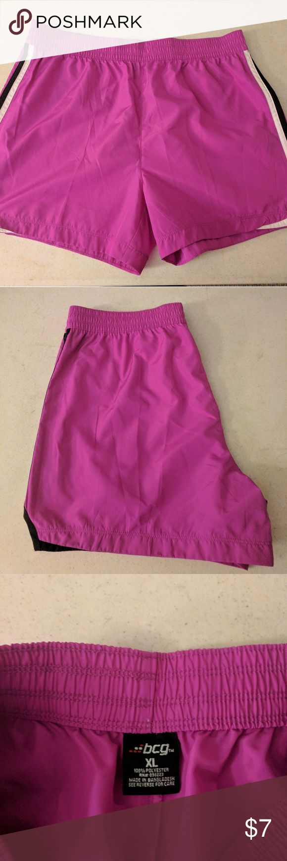 Hot Pink Workout Shorts BCG Workout shorts, size XL. Shorts are hot pink with a black and white stripe on sides. No lining inside shorts. 100% polyester. All items come from a smoke free home. BCG Shorts