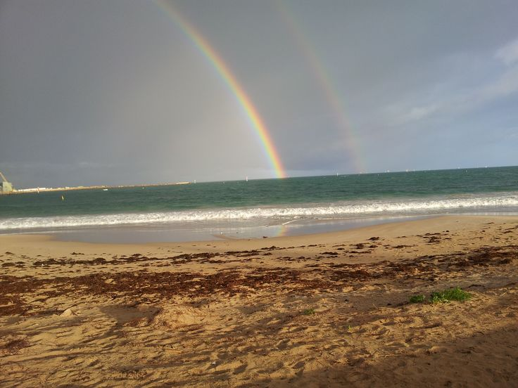 Rainbow with an echo. Taken at Geraldton Western Australia, on the fore-shore