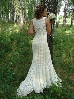 crochet wedding dress and it has a diagram! The top part is formed by several flowers crochet together. The bottom is repeating the same pattern; waste to bottom, this beauty comes with a bag.