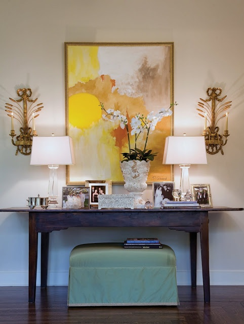 """Tablescape - """"The sophistication of crystal lamps, silver frames and orchids is a pleasing contrast to the antique French farm table...."""""""