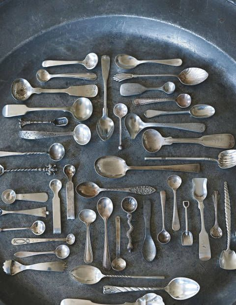 Rather than putting a collection of silver spoons in a drawer, Karch and Robertson suggest displaying them on a pewter charger.