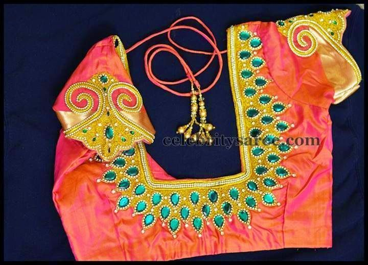 Orange and pinkish gold shades designer silk wedding blouse with classic maggam and stone work sleeves. Green color stones adorned around...