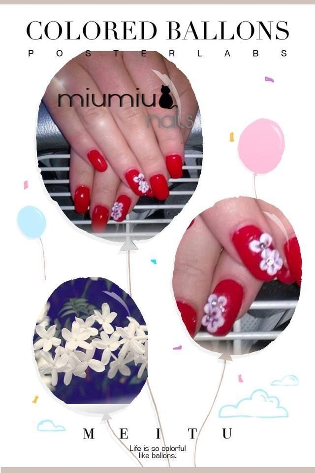 Red gel nail with Acrylic White Flower.