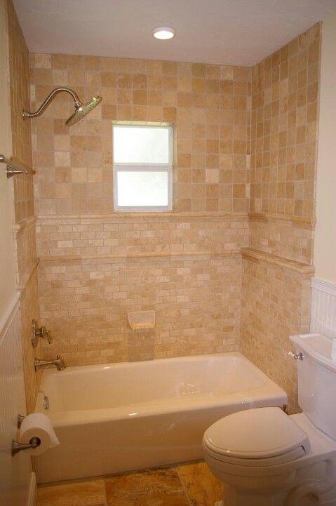 Elegant tile surround with varigated tan tiles in square pattern upper half