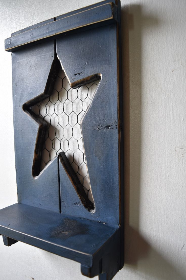 This Primitive Star Wall Decor Shelf will coordinate with any room. It has rusty chicken wire surrounding the Cut out Folk star, has been distressed and since this is a Rustic Saltbox Exclusive it can