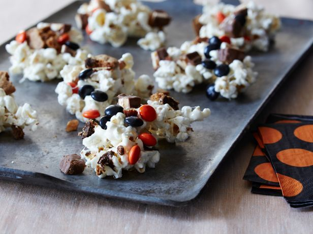 These aren't ordinary popcorn balls. Giada's sticky streats contain chopped chocolate bars, chocolate chip cookies, salted almonds and Halloween-colored candies.