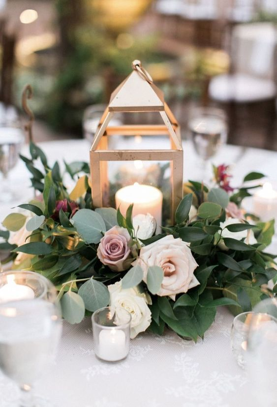 Gold Lantern centerpiece with ring of flowers and …