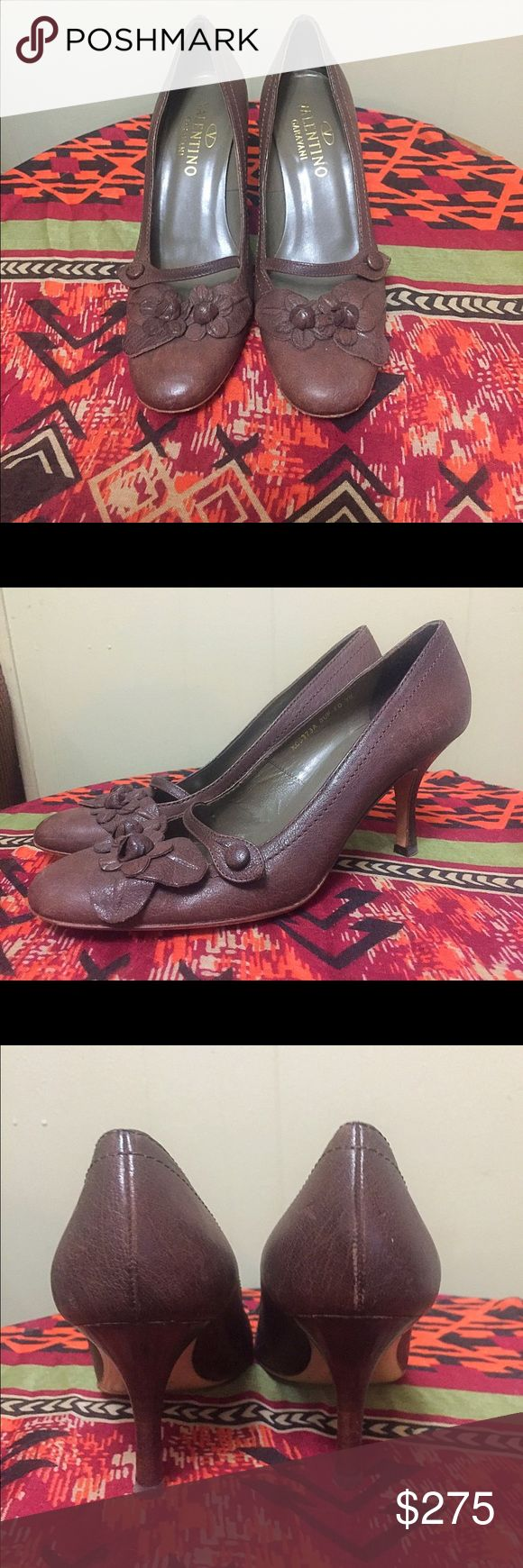 Vintage Valentino Brown Heels Absolutely gorgeous Valentino Garavani Brown Leather heels.Theres small strap with button secure your foot into the shoe. Leather flowers sit on the top of each shoe. The insoles are in excellent conditions with little signs of wear. There is some scuffing on the bottom of shoe displayed in pictures. These are in Excellent used condition. Women's size 38 Us 8 From a smoke free home. Valentino Shoes Heels