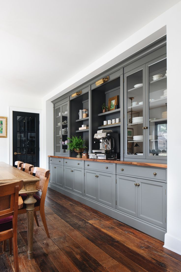 Coffee bar with gray blue cabinets, in dining room…