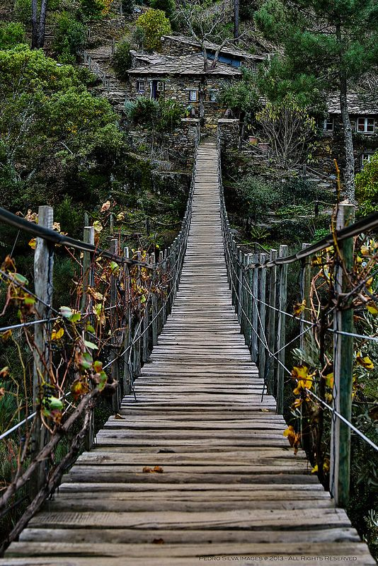 Suspended bridge to Foz D'Egua, Piódão, Arganil, Coimbra, Portugal. Piódão is a tiny ancient village whose buildings are made of schist, a stone found in great abundance in the region. | Photo from Pedro Silva on Flickr at: https://www.flickr.com/photos/pms_images/10785973765/in/set-72157637529953974 | under Copyright, all rights reserved.