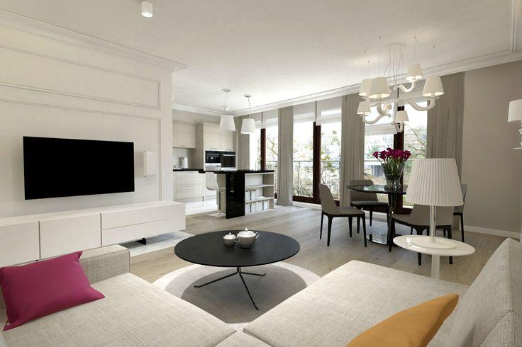 Salon w bieli i w bezach z czarnym stolikiem i kolorowymi dodatkami