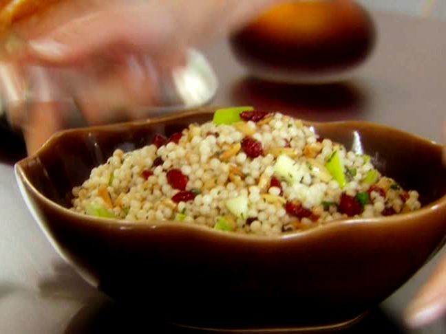 Israeli Couscous with Apples, Cranberries and Herbs from FoodNetwork.com--good fall side dish! This is good and a great side dish for potlucks.