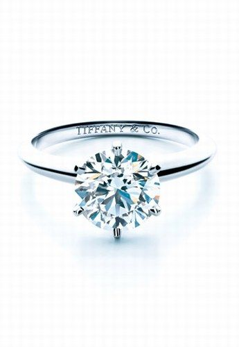 T Engagement Ring. It wouldn't have to be this big, as in karats but, I would love something kind of like this with a soft gold setting.