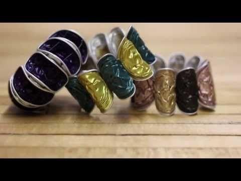 Recycled Coffee Capsule (like K-cups) Bracelet DIY . . . site leads to DIY Terra Cycle video which shows purple bracelet on model.