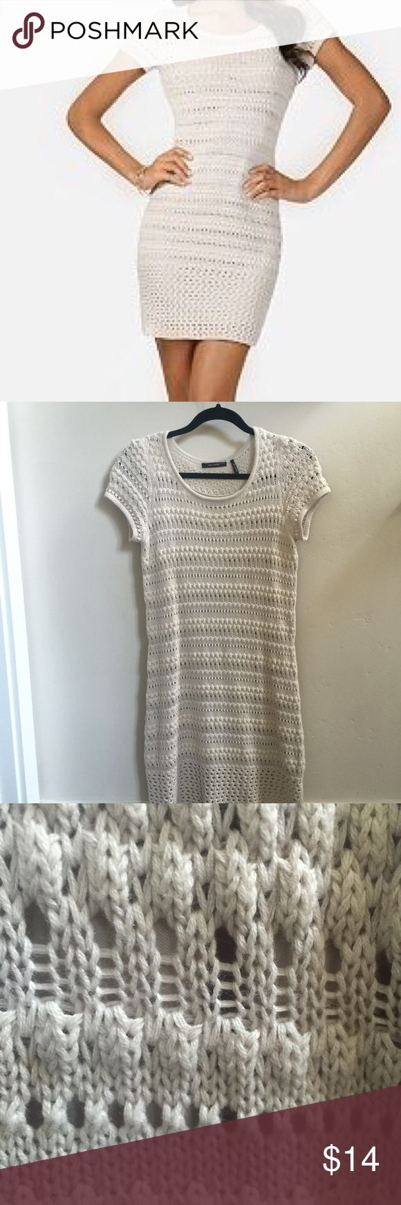 "Crochet Sweaterdress Cute, contemporary  crochet sweater dress in cream. Comfortable cotton blend. Fully lined with cream slip. Measures approximately 37"" from top of shoulder to bottom hem. Previously worn once to an event. Close to the body fit w some comfortable stretch. Daisy Fuentes Dresses"