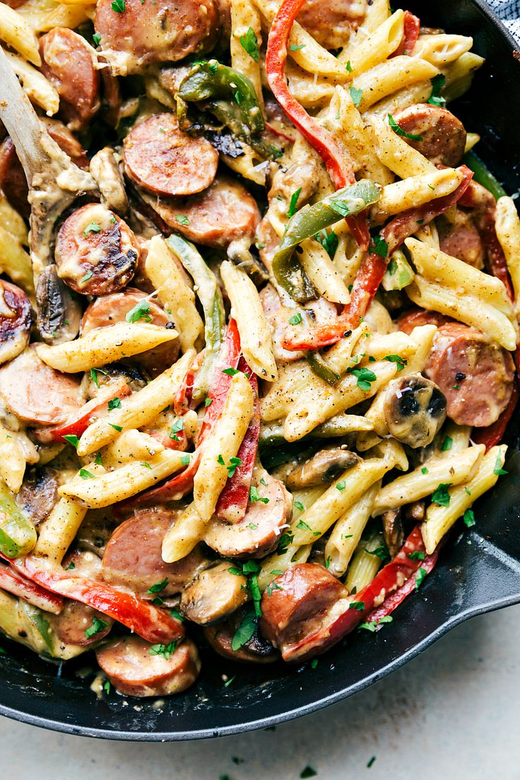 EASY ONE POT Creamy cajun sausage pasta and veggies made healthier for you! Recipe from chelseasmessyapron.com