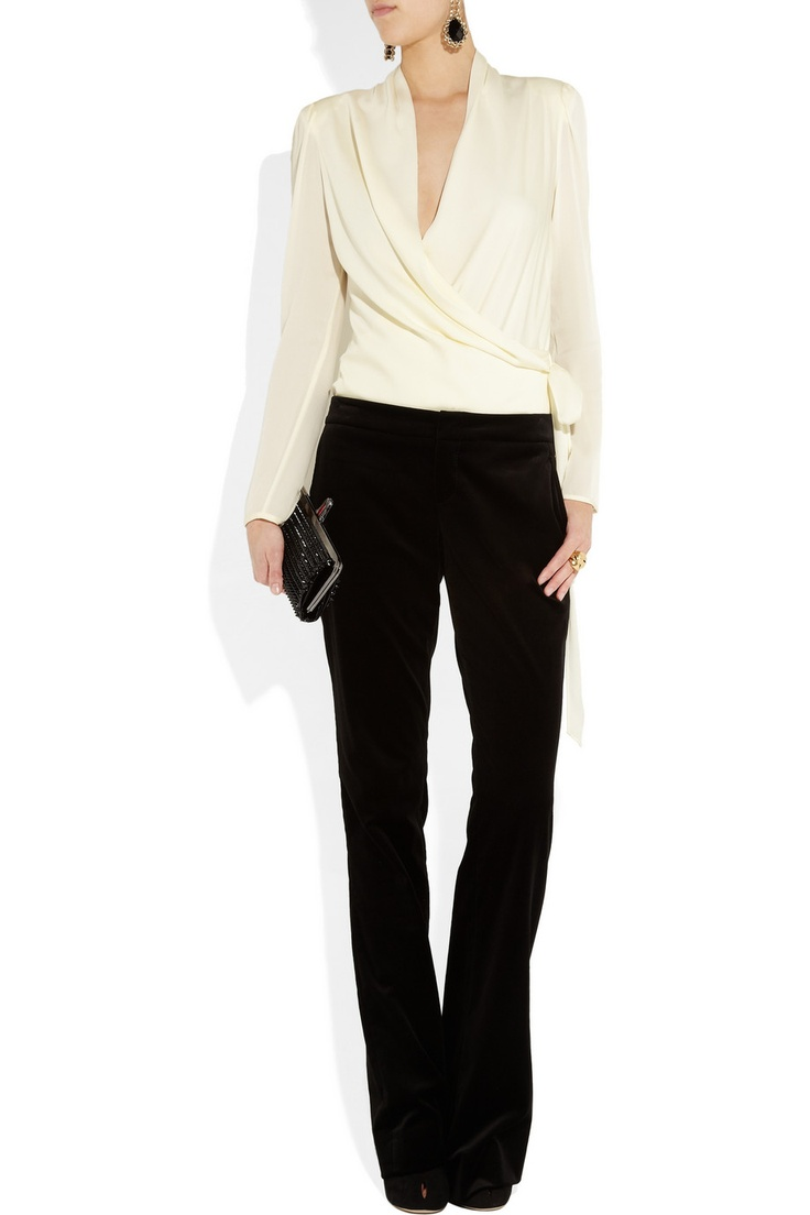 Catherine Malandrinowashed stretch-silk wrap-effect blouse, Etro earrings, Oscar de la Renta ring, Gucci pants, Diane von Furstenberg shoes, Christian Louboutin clutch.