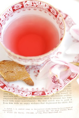 love the warm, bright chroma of the tea with the pastel pinks, white, and darker pink/red of the teacup design