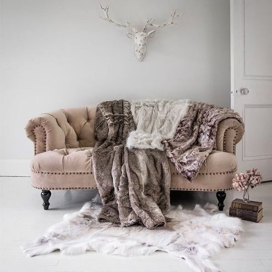 These faux fur blankets serve up an attractive invitation to sit down and stay a while.