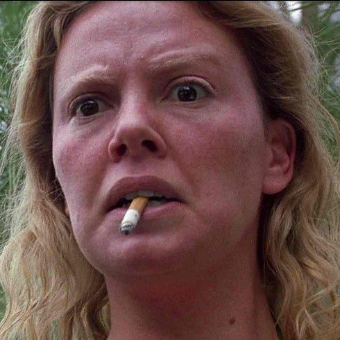 Charlize Theron as Aileen Wuornos in Monster | 23 Incredible Photos Of Actors Vs. The Historical Figures They Played