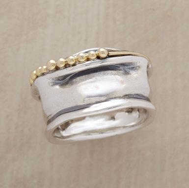 I think if I owned this ring, I would constantly be fascinated by its unique, melted metal look.