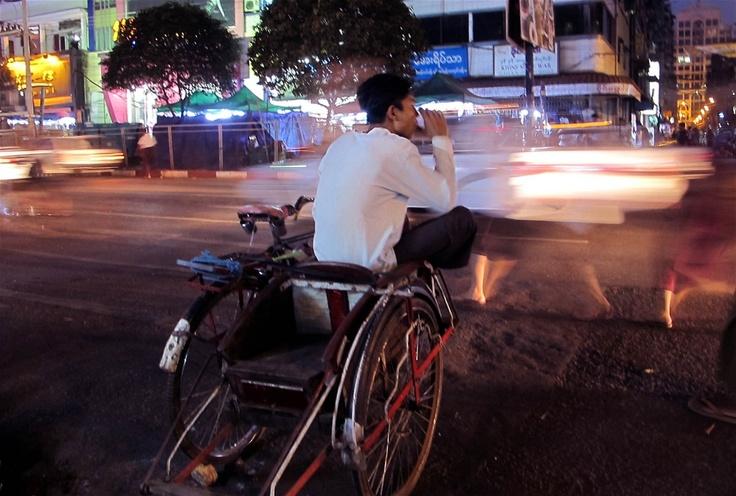 A rickshaw driver waits for customers as dusk falls in Yangon (March 2012)