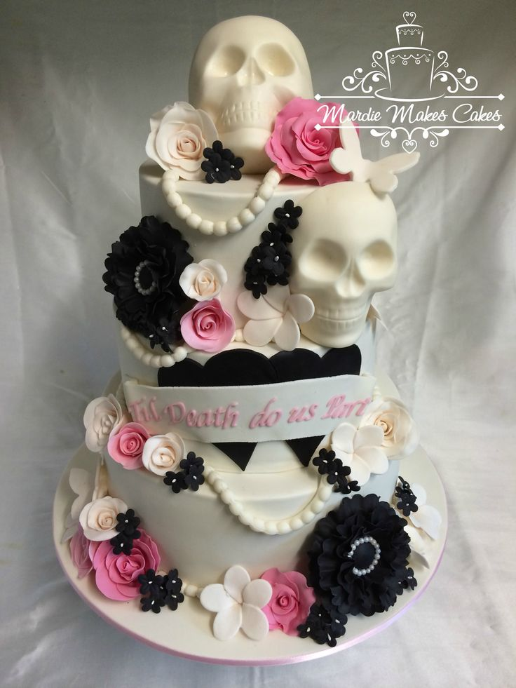Skulls Wedding Cake  - a unique wedding cake for a unique couple. all chocolate cakes with smbc filling and mmf everything else. thanks for looking :)