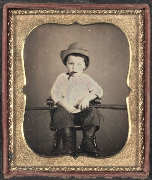 ca. 1855, [daguerreotype portrait of a child with a cigar] via the Cleveland Museum of Art, Photography Collection