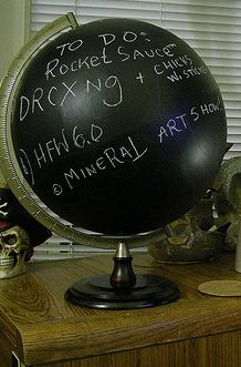 Just spray with Chalkboard paint.  Good idea if you find in a garage sale as many of the countries names and even some borders have changed