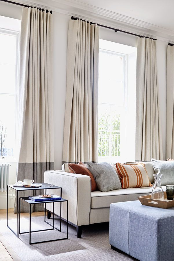 Straight-drop curtains in ivory with contrasting dove grey high hem section.