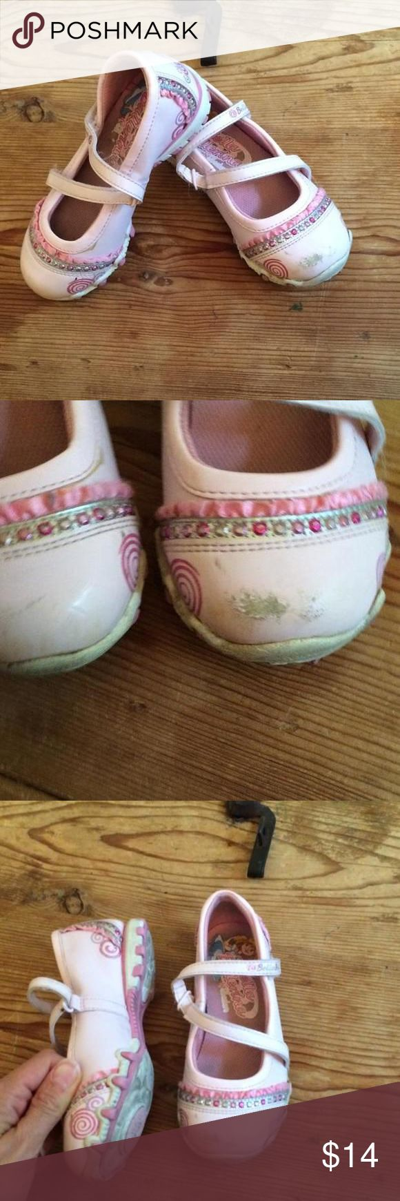 Skechers Bella Ballerina 10.5 spin shoes These are the Bella Ballerina shoes by Skechers that have the little spinning circles on the soles so you can twirl to your heart's content. A little toe scuffing, but otherwise lots of prancing & dancing life left. Skechers Shoes