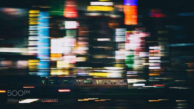 Breaking Through Kabukicho by tclin with citynighttraintransportationurbanlightsmovementviewlongstationlong exposureflowpanningmetropolispanTokyoJapanShinjukuJRKabukicho