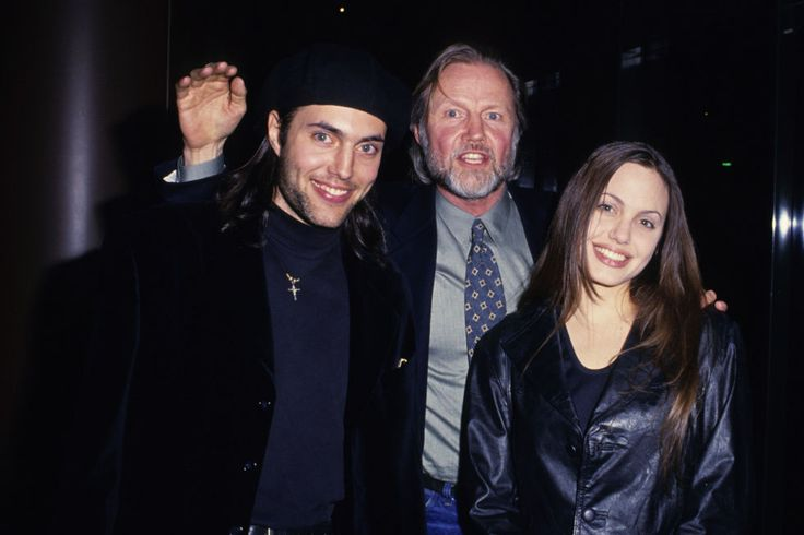 Angelina Jolie with her brother, James Voight, and father, Jon Voight, at the 25th anniversary party for Midnight Cowboy in February 1994, sporting a snappy leather blazer. See 19 more rarely-seen portraits of the actress over the past four decades.