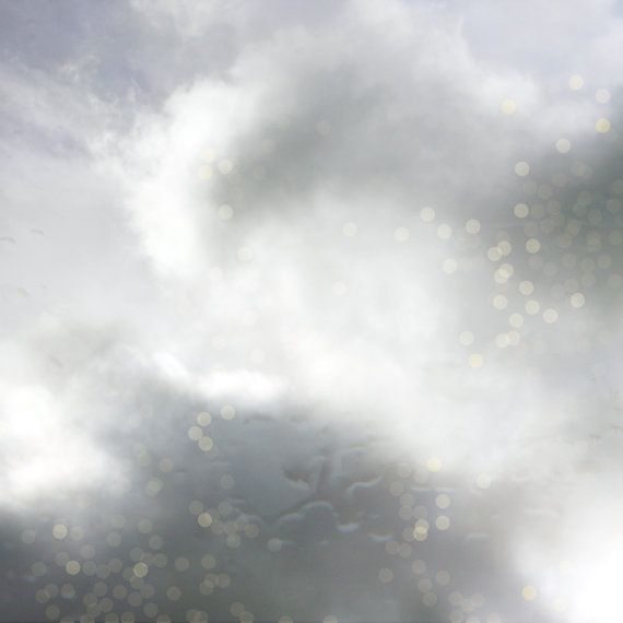 Confetti Skies : Photographic Print of fluffy storm clouds overlain with rain & confetti like graphic circles