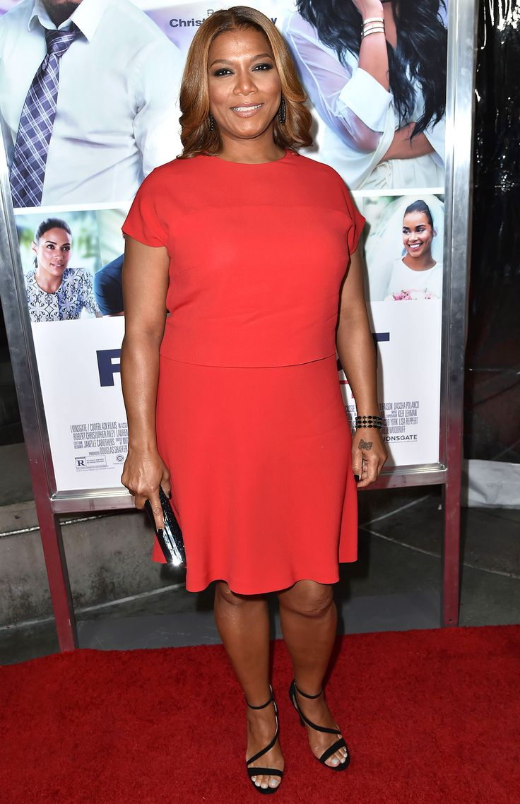 QUEEN LATIFAH in a cap-sleeve fit-and-flare dress with open-toe sandals at the premiere of The Perfect Match in L.A.