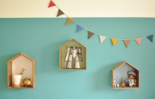Use little wooden house shelves to display children's treasures.