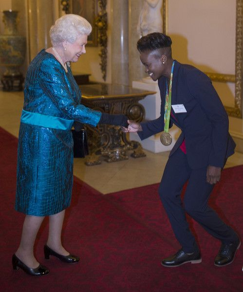 Queen Elizabeth II Photos Photos - Queen Elizabeth II speaks with Nicola Adams at a reception for Team GB's 2016 Olympic and Paralympic teams at Buckingham Palace October 18, 2016 in London, England. - Olympics & Paralympics Team GB - Rio 2016 Victory Parade