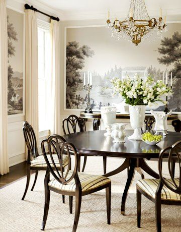 Lovely white centerpiece combining flowers and carved porcelain. The finishing touch to an elegant traditional dining room.