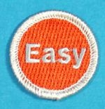 Fun Spoof badges from the Boy Scouts (but many of these can be used for girls too) that are much cheaper than the Disorderly Conduct Badges and Nerd Merit Badges. This is the famous Staples Easy Button.