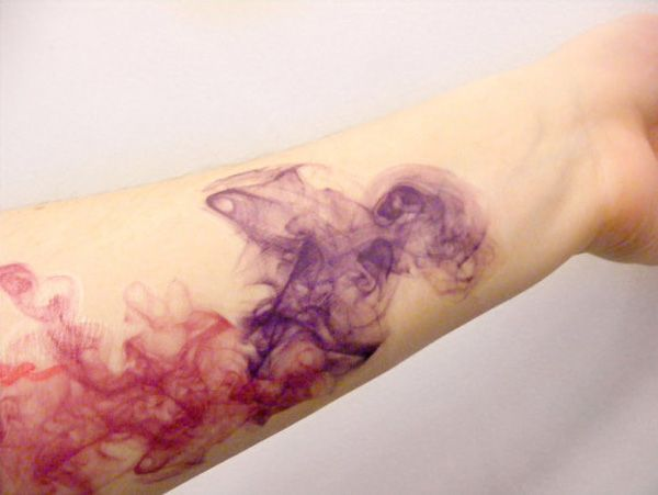 This is the kind of abstract watercolor tattoo that I love! Looks like ink in water.